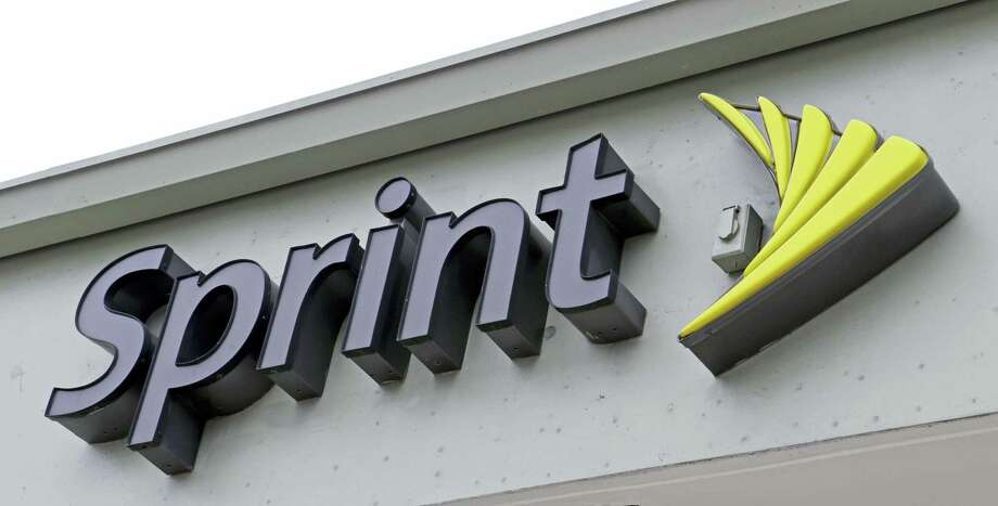 This Oct. 28, 2016 photo shows a Sprint sign in Miami. Sprint is buying a 33 percent stake in Tidal, the music streaming service owned by artists including Jay-Z, Madonna and Kanye West, the companies announced Monday, Jan. 23, 2017. Photo: AP Photo/Alan Diaz  / Copyright 2016 The Associated Press. All rights reserved.
