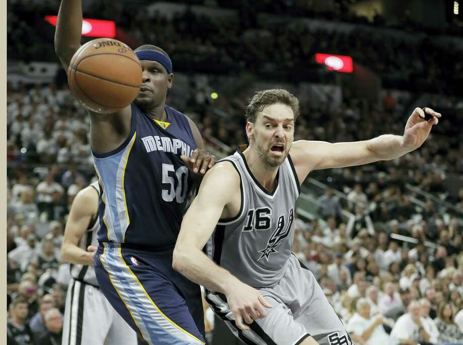 Memphis Grizzlies forward Zach Randolph (50) and San Antonio Spurs center Pau Gasol (16) chase a loose ball during the first half Game 1 in a first-round NBA basketball playoff series April 15, 2017 in San Antonio. Photo: AP Photo — Eric Gay  / Copyright 2017 The Associated Press. All rights reserved.