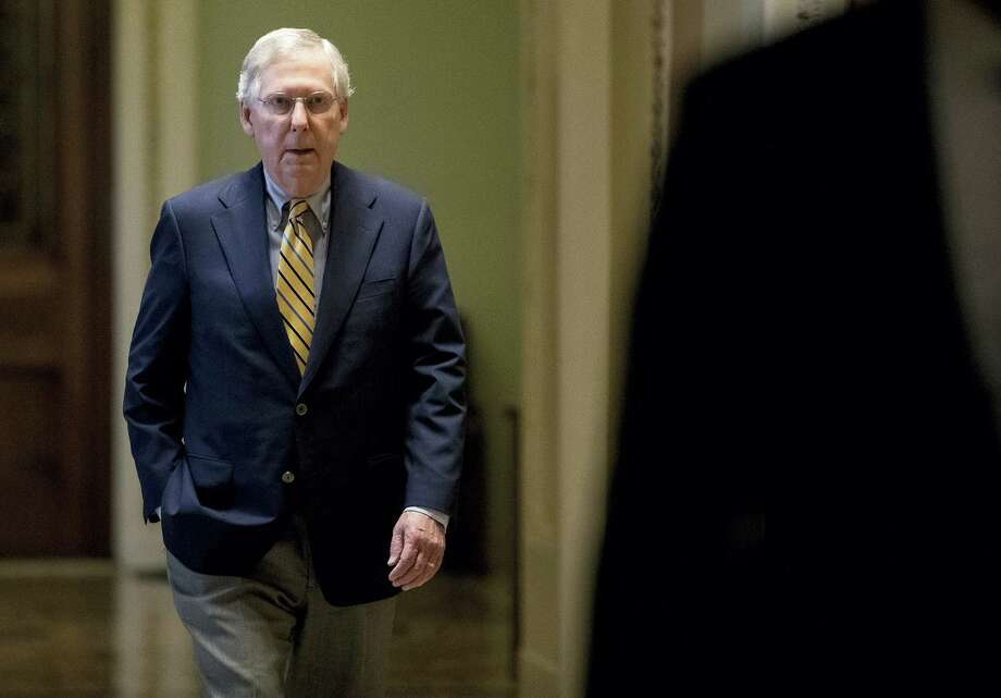 Senate Majority Leader Mitch McConnell of Ky. arrives on Capitol Hill in Washington on July 17, 2017. The Senate has been forced to put the republican's health care bill on hold for as much as two weeks until Sen. John McCain, R-Ariz., can return from surgery. Photo: AP Photo — Andrew Harnik  / Copyright 2017 The Associated Press. All rights reserved.
