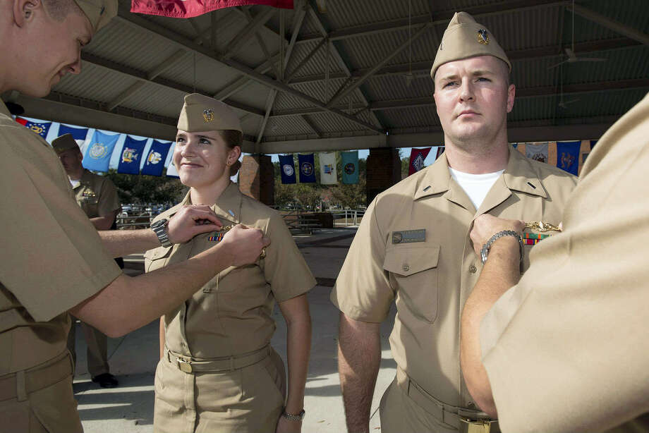 In this Dec. 5, 2012 photo, released by the U.S. Navy, Lt. j.g. Marquette Leveque, left, and Lt. j.g. Kyle McFadden, both of the USS Wyoming, receive their pins to indicate that they're qualified to serve on submarines in a ceremony at Naval Submarine Base Kings Bay in Georgia. With women now serving on submarines, future subs are being built to specifically accommodate gender differences including height, reach and strength. The first vessel built with some of the new features is expected to be delivered in 2021. Photo: James Kimber — U.S. Navy Via AP, File  / U.S. Navy