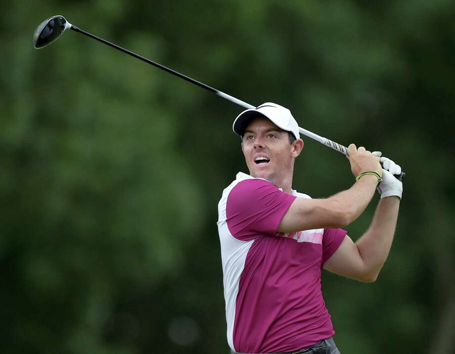 Rory McIlroy reacts after his tee shot on the 18th hole during the second round of the Travelers Championship on Friday. Photo: Brad Horrigan — Hartford Courant Via AP  / Hartford Courant