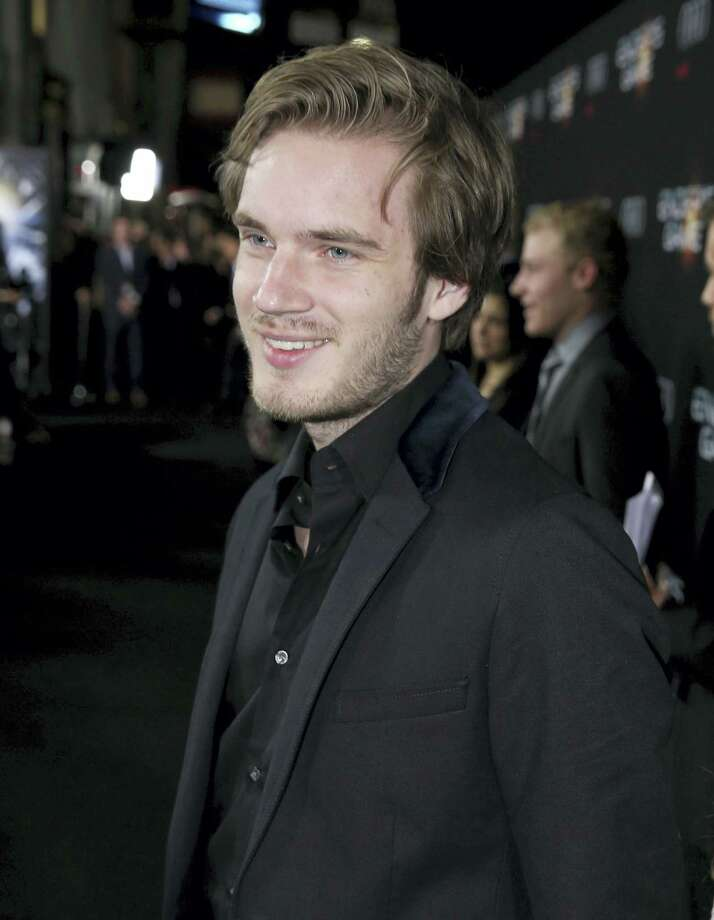 """In this Oct. 28, 2013 photo, Felix """"PewDiePie"""" Kjellberg's arrives at the Los Angeles premiere of """"Ender's Game"""" at TCL Chinese Theatre in Los Angeles. Kjellberg has been dropped from Disney'Äôs Maker Studios and YouTube has cancelled his reality series following a Wall Street Journal report on Feb. 13, 2017 that he made anti-Semitic videos. Photo: Photo By Matt Sayles/Invision/AP, File  / Invision"""