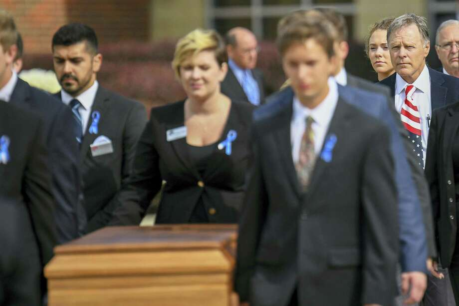 Fred Warmbier, right, follows the casket of his son, Otto, out of Wyoming High School after his funeral, Thursday, June 22, 2017, in Wyoming, Ohio. Otto Warmbier, a 22-year-old University of Virginia undergraduate student who was sentenced in March 2016 to 15 years in prison with hard labor in North Korea, died this week, days after returning to the United States. Photo: AP Photo/Bryan Woolston   / FR171481 AP