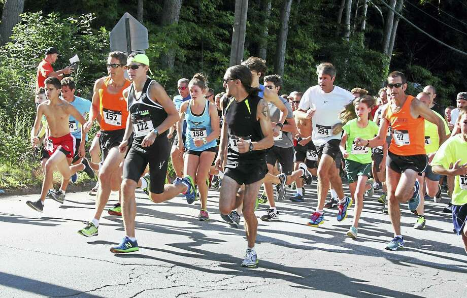 The Clinton Chamber of Commerce and Shoreline Community Women, Inc. will host the 20th Annual Steward's Ace Hardware 5K Road Race on Saturday August 12, 2017. The 5k (3.1-mile) race course begins and ends at the Jared Eliot Middle School, 69 Fairy Dell Road in Clinton.  Start time is 9 a.m., with race day registrations beginning at 7:30 a.m.  Mile markers will be measured as such from the course certification (USATK Certified #CT15024JHP).  There are several water stations along the route.  Last year's race drew over 400 entrants.The Clinton Police Department will be closing the race route to all vehicular traffic between 9 and 10 am due to safety concerns.Electronic bib-chip timing is managed by Rat Race Timing.  In addition to title sponsor Steward's Ace Hardware, sponsors include: MacKinstry Financial & Investments, La Foresta, Harborside Marina & Yacht Sales, DLS Insurance Center, Physical Therapy & Sports Medicine, American Legion Post #66, Middlesex Hospital Homecare, The UPS Store, Lemley Electric, Clinton Glass, Stanpak LLC, Preferred Foam Products, The Lee Co., Child & Adult Orthodontics, Hibu, Rocky's Aqua, Shore Publishing, Cohen's Bagels, Chips Pub III, Stop and Shop, Shoreline Financial Group, Mohegan Sun, Technique Printers, and Snap Fitness. Music will be provided by disc jockey DJ Michael John of Long Island Sounds Entertainment.  Registration is $25 through August 5. From August 6 to race day, registration will be $30. Registration forms are available online at www.clintonct.com/road-race , from participating sponsors, or at the Clinton Chamber of Commerce, 50 East Main Street, Clinton, CT 06413. Online registration is also available at www.active.com. Money raised through this race directly benefit Shoreline Community Women and the Clinton Chamber... Photo: Digital First Media
