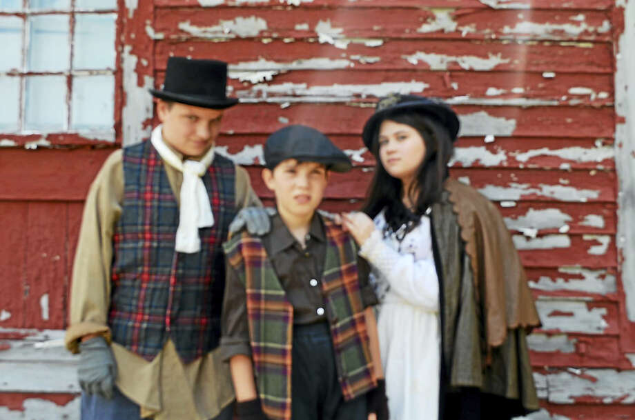Above, from left, are Will Curry (Clinton) as Fagin; Gabriella Onorati (Madison) as Nancy and Matthew Law (Guilford) playing a hapless orphan.  Not pictured:  Brayden Esler (Clinton) as Oliver and Isabelle Schreiner (Madison) as the Artful Dodger. Photo: Photo Courtesy Of Kidz Konnection