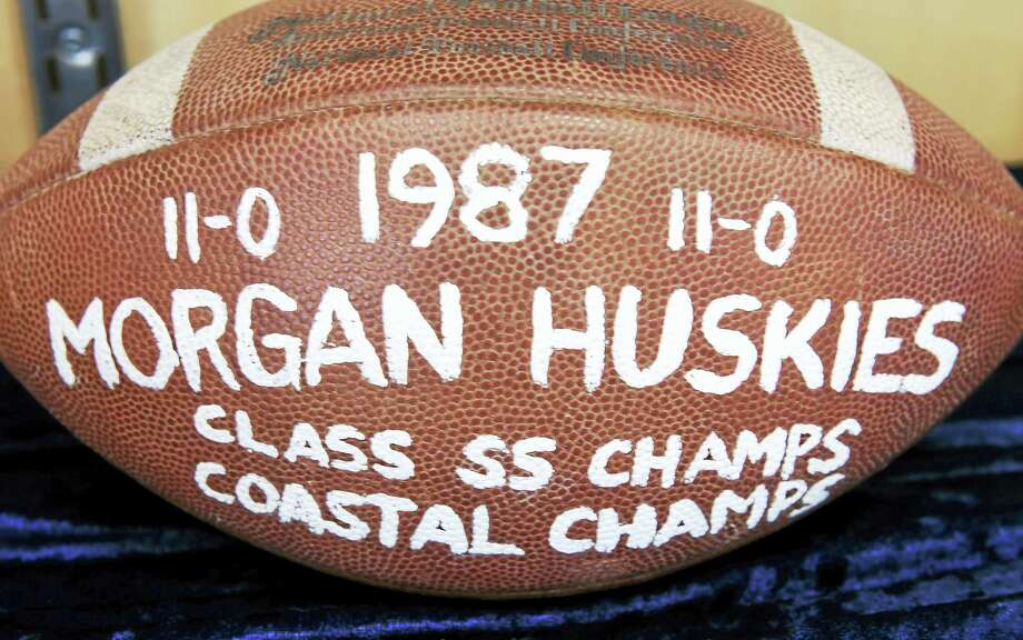 A football commemorating the 1987 SS State Championship football team is exhibited in a display case at the new Morgan School in Clinton. Photo: Arnold Gold — New Haven Register