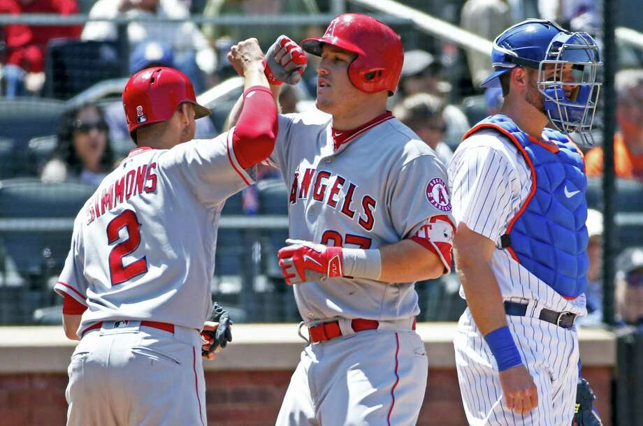 The Angels' Mike Trout (27) Andrelton Simmons at the plate after hitting a second-inning, two-run home run on Sunday. Photo: Kathy Willens — The Associated Press  / Copyright 2017 The Associated Press. All rights reserved.