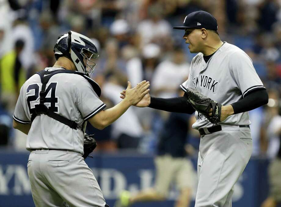 Yankees pitcher Dellin Betances, right, celebrates with Gary Sanchez after Sunday's win. Photo: Chris O'Meara — The Associated Press  / Copyright 2017 The Associated Press. All rights reserved.