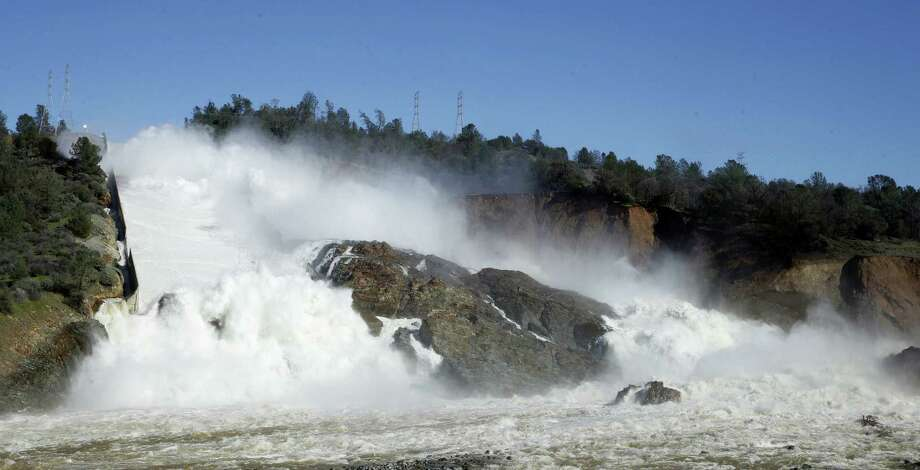"""In this Feb. 11, 2017 photo, water flows down Oroville Dam's main spillway, near Oroville, Calif. Officials have ordered residents near the Oroville Dam in Northern California to evacuate the area Sunday, Feb. 12, saying a """"hazardous situation is developing"""" after an emergency spillway severely eroded. Photo: AP Photo/Rich Pedroncelli  / Copyright 2017 The Associated Press. All rights reserved."""