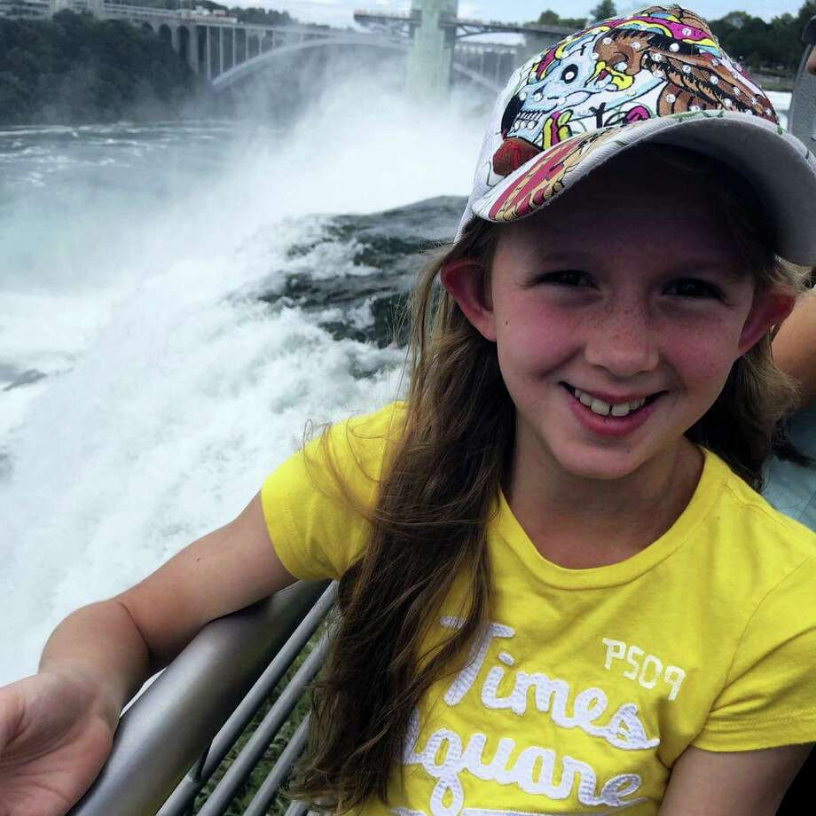 This undated photo provided by Heather Kester, shows Savannah, at Niagara Falls, N.Y., whose mother requested only her first name be used and who is a young Mormon girl that told her congregation during a Sunday service she is a lesbian before her microphone was turned off by local church leaders. Savannah's emotional speech is sparking a new round of discussions about how the conservative religion handles LGBT issues. Photo: Heather Kester Via AP  / HEATHER KESTER