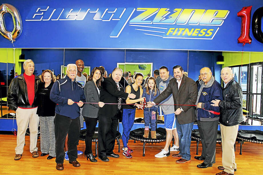 Energy Zone Fitness had a grand opening in Cromwell Jan.14 at 199 Shunpike Road. It offers a variety of group classes from Energy Bounce, P90x live and boot camp. President of the Middlesex County Chamber of Commerce Larry McHugh joined owner Julie Cranick, her family, staff, Cromwell town officials and the business community, including state Rep. Christie Carpino, Chamber Cromwell Division Chair Jay Polke, Cromwell Mayor Enzo Faienza and Cromwell Town Manager Anthony Salvatore. Photo: Contributed Photo