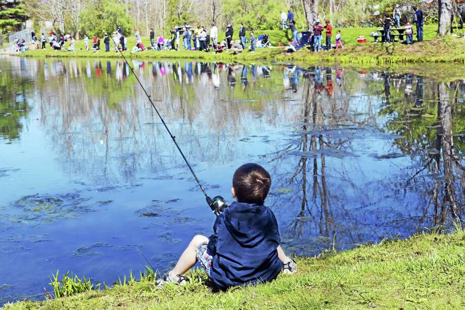 More than 200 children tried their hands at catching trout city's fishing derby last year at Butternut Hollow Park in Middletown. Photo: File Photo