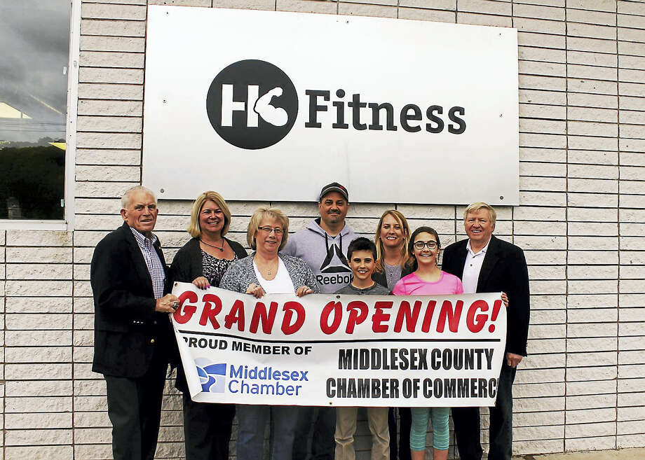 HK Fitness held a grand opening May 15 in Higganum. From left are President of the Middlesex County Chamber of Commerce Larry McHugh, Haddam First Selectman Lizz Milardo, chairman of the Haddam Economic Development Commission Cindy McNeil Sola, co-owner of HK Fitness Merle McKenzie, Jack McKenzie, co-owner of HK Fitness Diana McKenzie, Grace McKenzie and Middlesex Chamber's East Haddam/Haddam Division chairman Mike Bennett. Photo: Courtesy Middlesex County Chamber Of Commerce