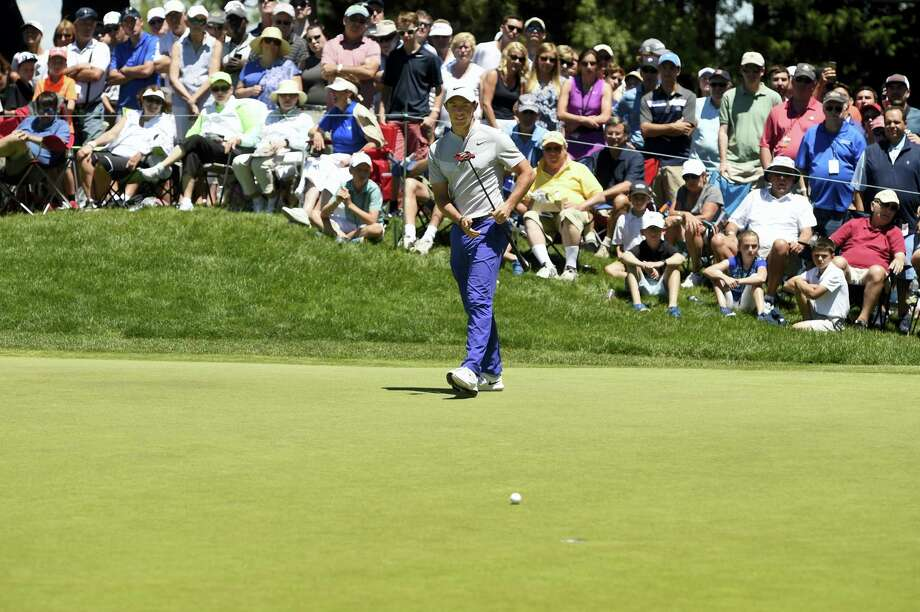 Rory McIlroy walks towards his putt after missing a birdie attempt on the ninth hole during the first round of the Travelers Championship on Thursday. Photo: John Woike — Hartford Courant Via AP  / Hartford Courant
