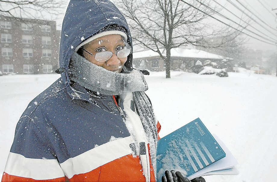 "Stephanie V. Johnson of Middletown walks up Church Street after completing a job interview at Middlesex Hospital in February 2003. ""I got the job. Maybe they liked my determination,"" she said. Photo: Middletown Press Archives"