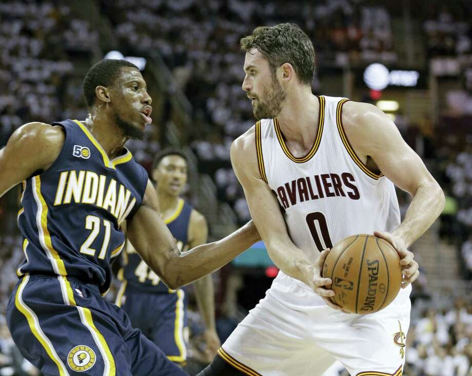 Cleveland Cavaliers' Kevin Love (0) drives against Indiana Pacers' Thaddeus Young (21) in the first half in Game 2 of a first-round NBA basketball playoff series on April 17, 2017 in Cleveland. Photo: AP Photo — Tony Dejak  / AP 2017