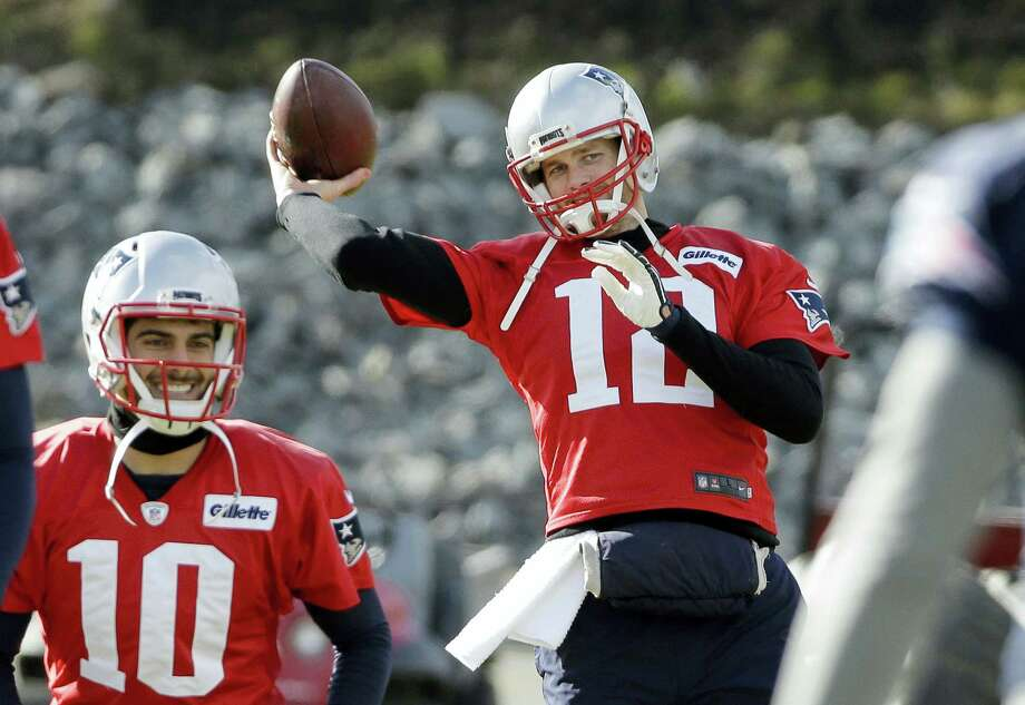 Patriots quarterback Tom Brady (12) winds up to throw the ball during a recent practice. Photo: Steven Senne — The Associated Press  / Copyright 2017 The Associated Press. All rights reserved.