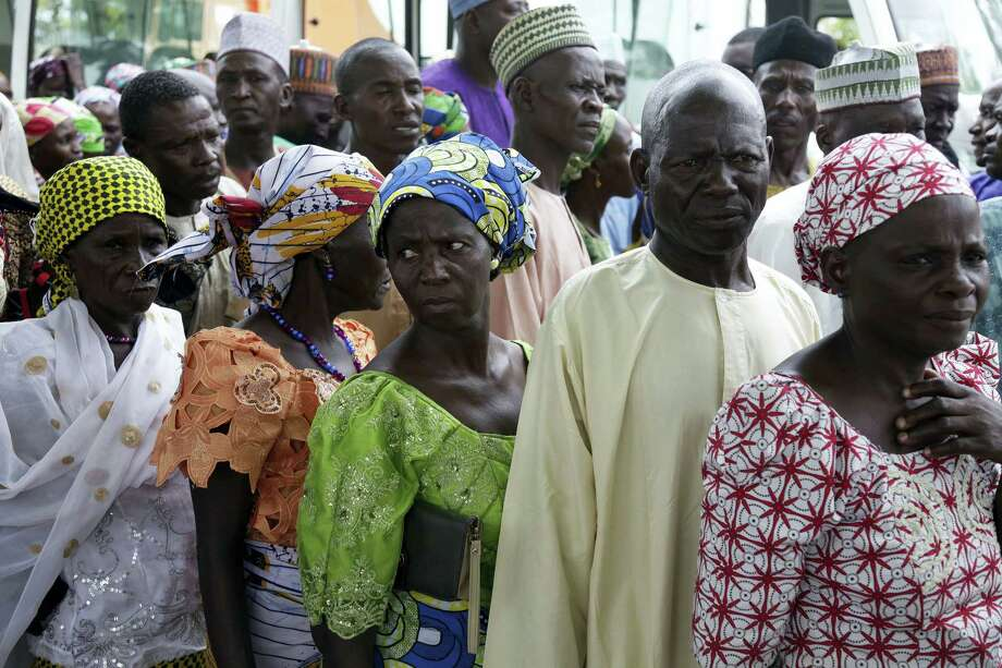 Parents of the kidnapped schoolgirls wait to be transported to they venue where they will be reunited with their daughters, in Abuja, Nigeria, Saturday, May 20, 2016. Officials say the 82 Nigerian schoolgirls recently released after more than three years in Boko Haram captivity are reuniting with their families for the first time. Photo: AP Photo/Sunday Alamba   / Copyright 2017 The Associated Press. All rights reserved.