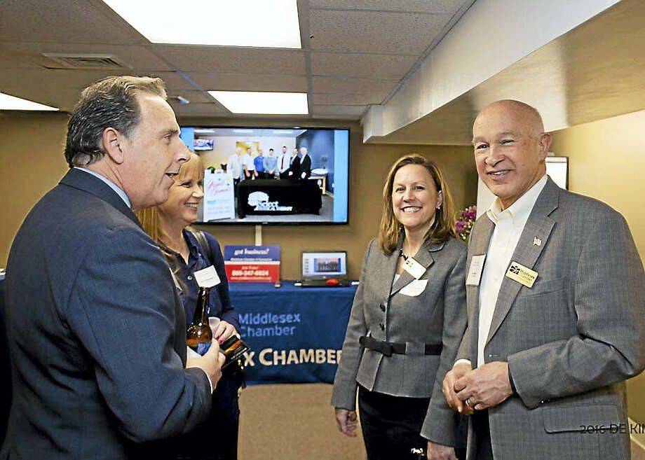 The Middlesex Chamber recently hosted an open house for new members where over 60 guests networked and learned about the benefits of chamber membership. From left, new members Guy Tommasi and Wendy Shumway and Middlesex Chamber Ambassador Program Co-Chairs Kelly Therrien and Jim Cama. Photo: Courtesy De Kine Photo LLC  / (c)DE KINE PHOTO LLC