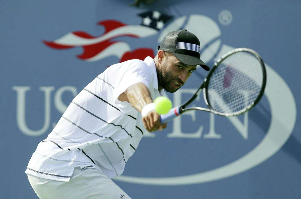In this Aug. 27, 2012 photo, James Blake returns a shot to Lukas Lacko, of Slovakia, in the first round of play at the 2012 US Open Tennis tournament in New York.