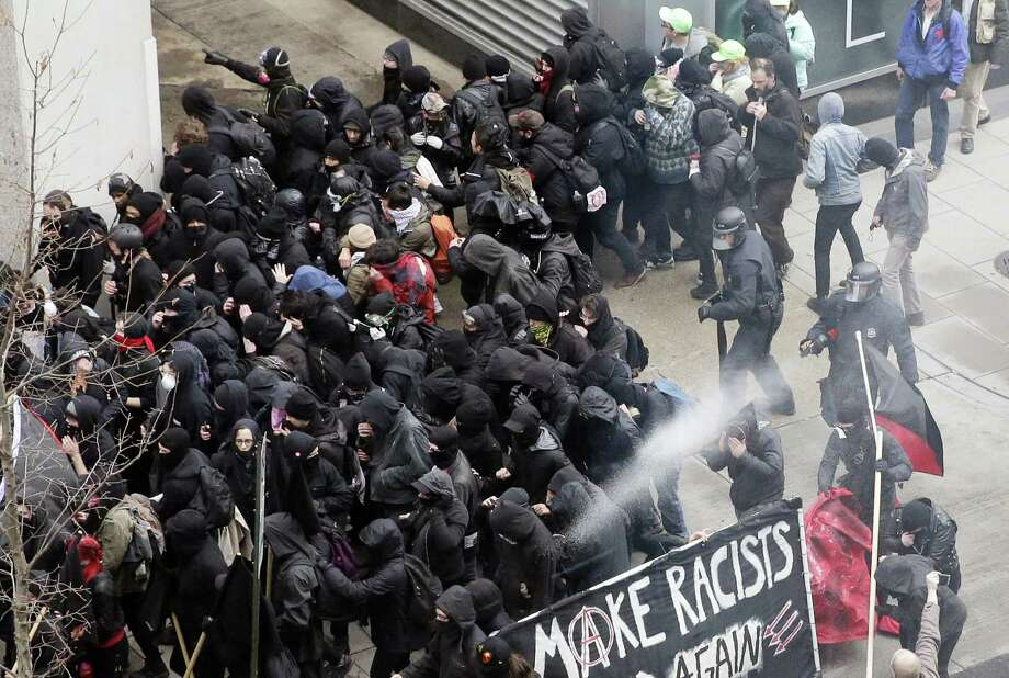 Police use pepper spray on protesters in Washington, Friday in a chaotic confrontation blocks from Donald Trump's inauguration as protesters registered their rage against the new president. Photo: Mark Tenally — The Associated Press  / Copyright 2017 The Associated Press. All rights reserved.