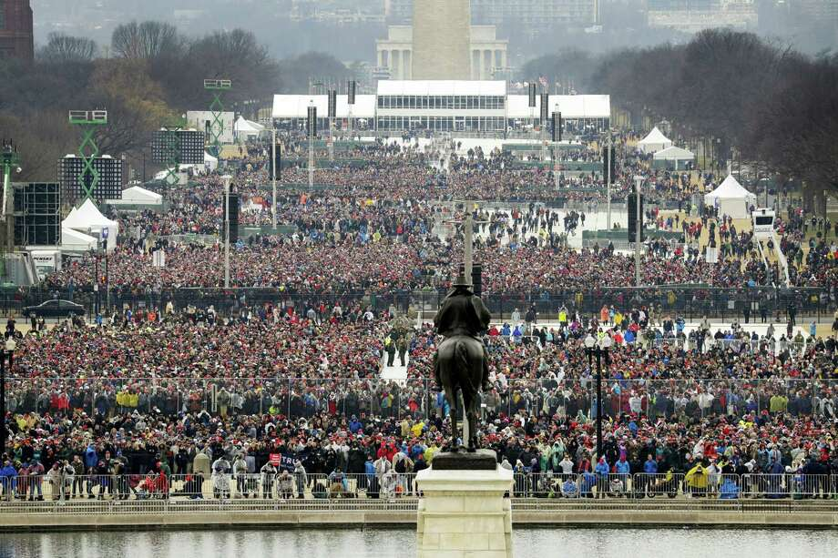 People stand on the National Mall to listen to the 58th Presidential Inauguration for President Donald Trump at the U.S. Capitol in Washington, Friday, Jan. 20, 2017. (AP Photo/Patrick Semansky) Photo: AP / Copyright 2017 The Associated Press. All rights reserved.