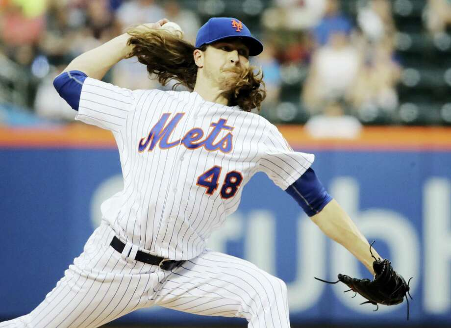 The Mets' Jacob deGrom delivers a pitch during the first inning Friday. Photo: Frank Franklin II — The Associated Press  / Copyright 2017 The Associated Press. All rights reserved.