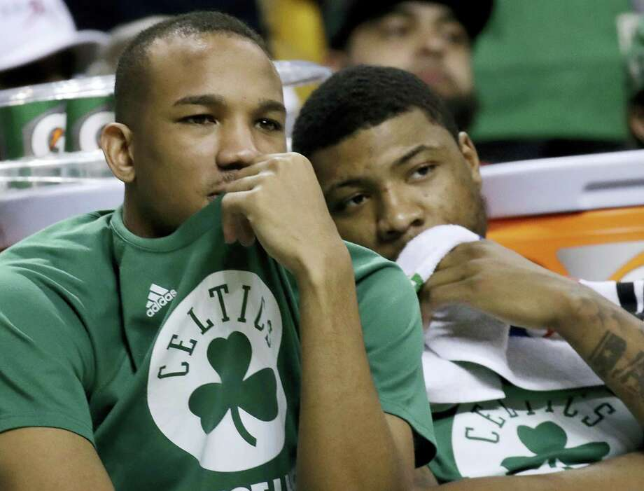 Celtics guards Avery Bradley, left, and Marcus Smart watch from the bench on Friday. Photo: Elise Amendola — The Associated Press  / Copyright 2017 The Associated Press. All rights reserved.