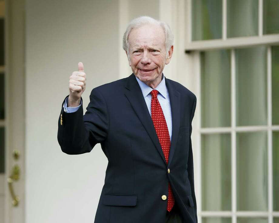 Former Connecticut Sen. Joe Lieberman gives a 'thumbs-up' as he leaves the West Wing of the White House in Washington, Wednesday, May 17, 2017. The White House says President Donald Trump will be interviewing four potential candidates to lead the FBI. (AP Photo/Pablo Martinez Monsivais) Photo: AP / Copyright 2017 The Associated Press. All rights reserved.