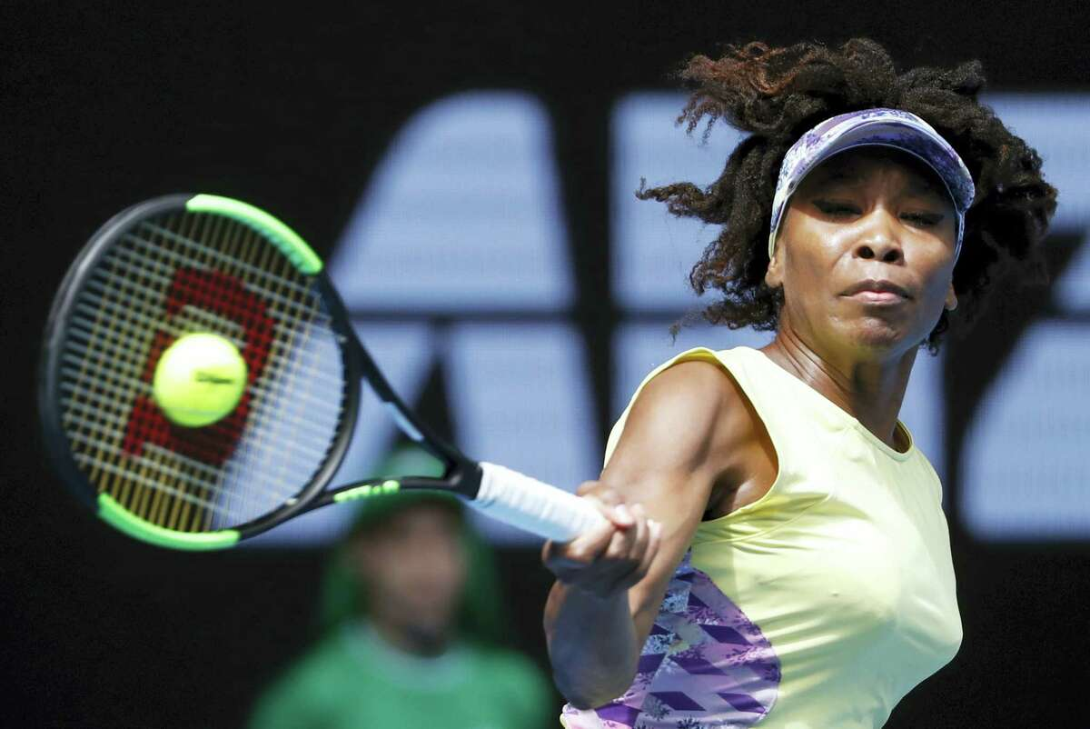 Venus Williams hits a forehand return to Stefanie Voegele during their second-round match earlier this week.