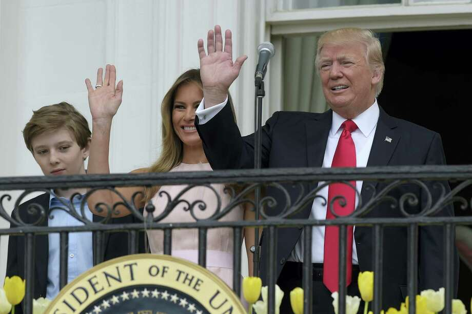 President Donald Trump, accompanied by first lady Melania Trump and their son Barron Trump, wave as they arrive for the annual White House Easter Egg Roll on the South Lawn of the White House in Washington on April 17, 2017. Photo: AP Photo — Susan Walsh  / Copyright 2017 The Associated Press. All rights reserved.