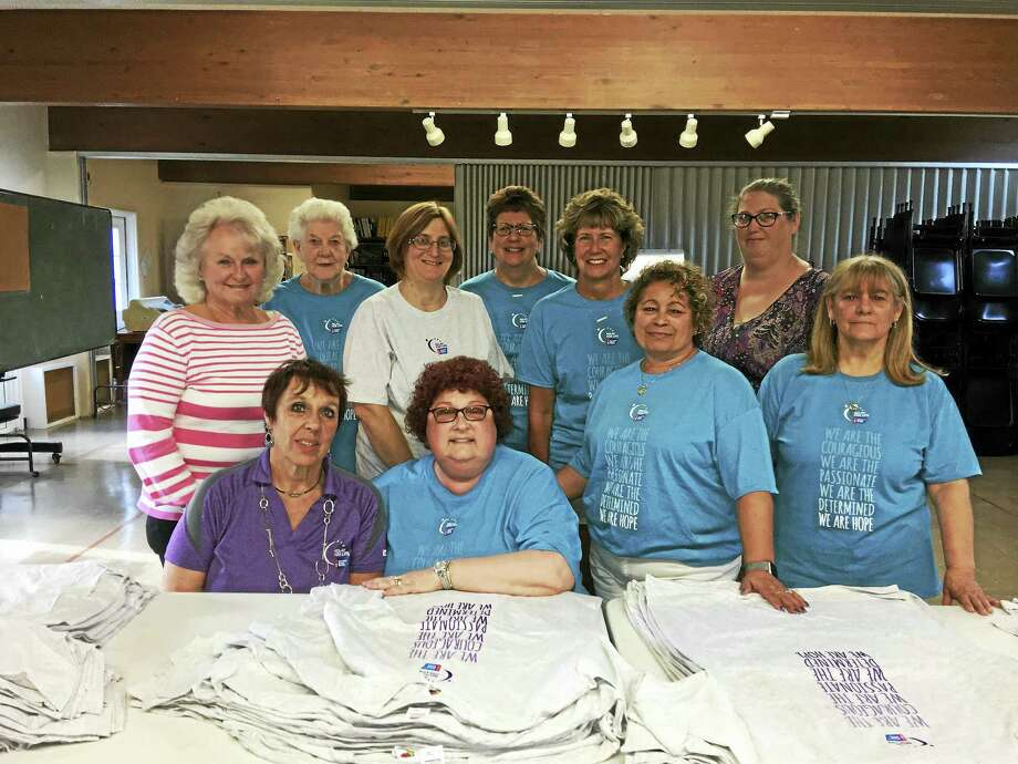 Middletown Relay for Life volunteers and committee members sorted shirts for team distribution at Grace Lutheran Church on Randolph Road Wednesday evening. Photo: Contributed PHOTO / Patti Deegan
