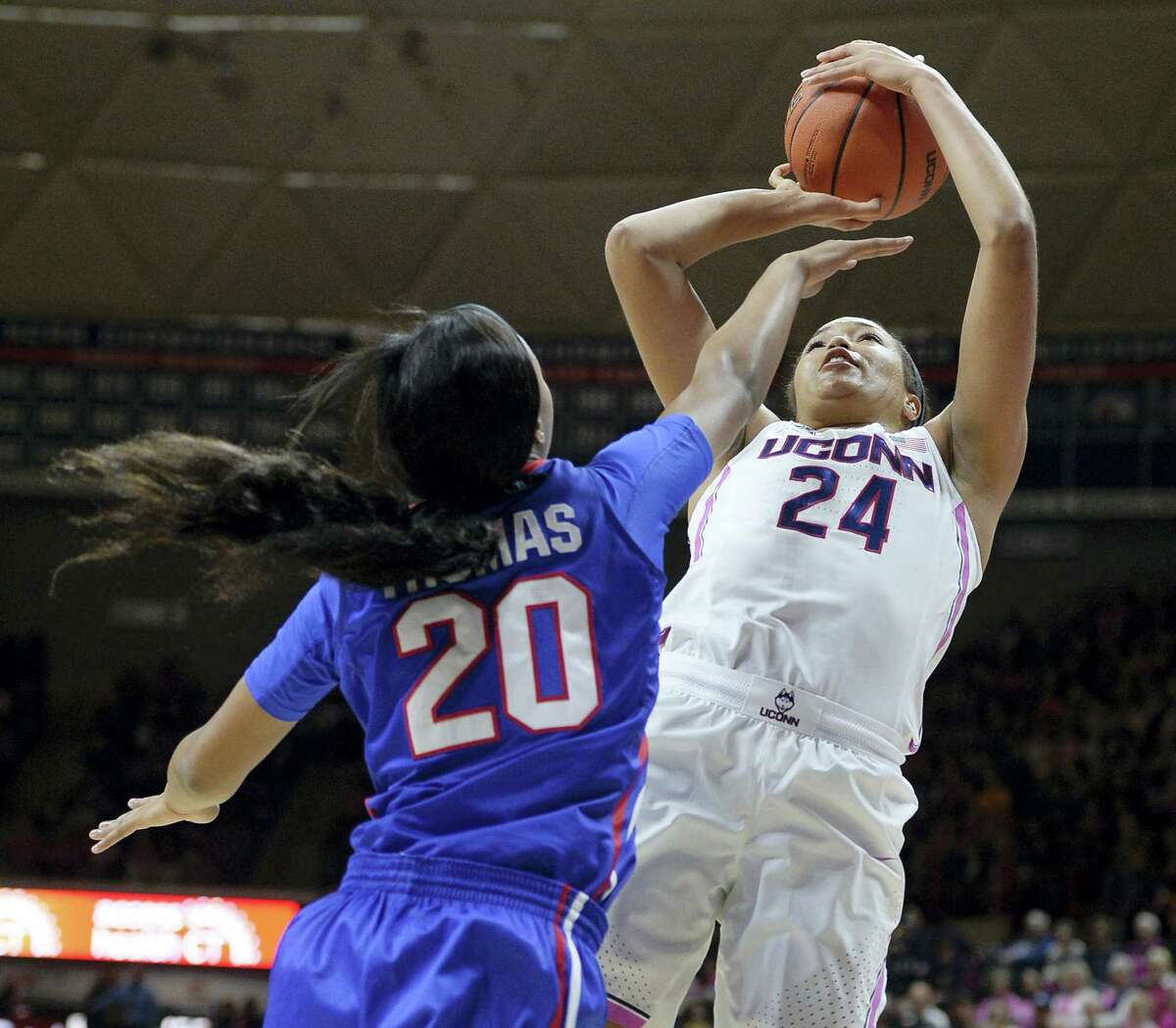 UConn's Napheesa Collier shoots as SMU's Dai'ja Thomas, left, defends in the first half.