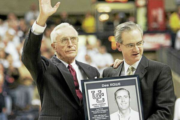 Former UConn head coach Dee Rowe waves to the crowd during a 2007 ceremony.