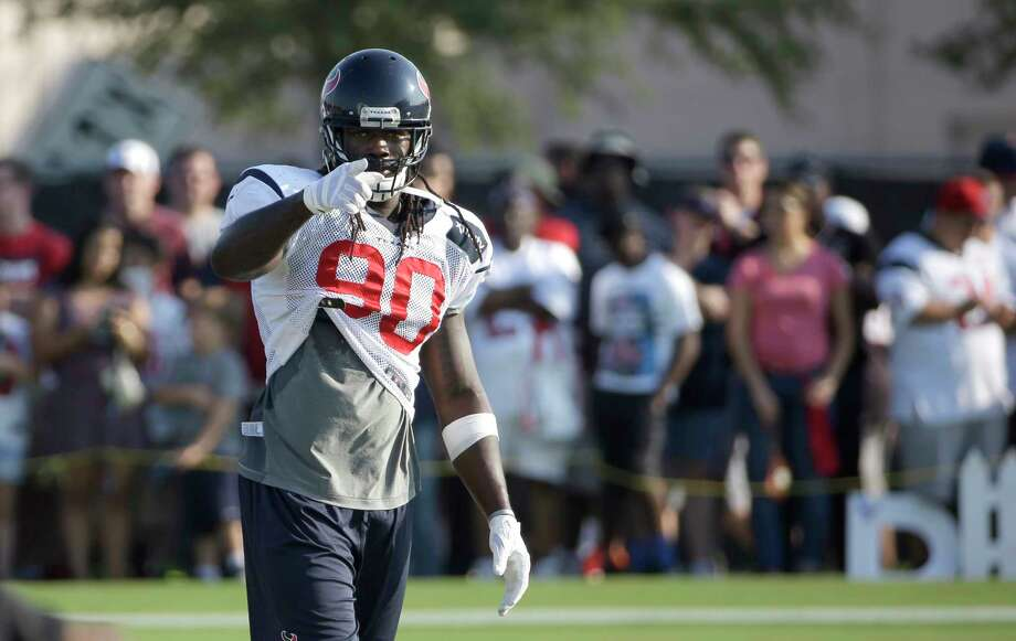 Houston Texans linebacker Jadeveon Clowney points to the sideline during an NFL football training camp practice Thursday, Aug. 14, 2014, in Houston. (AP Photo/David J. Phillip) Photo: David J. Phillip, STF / AP
