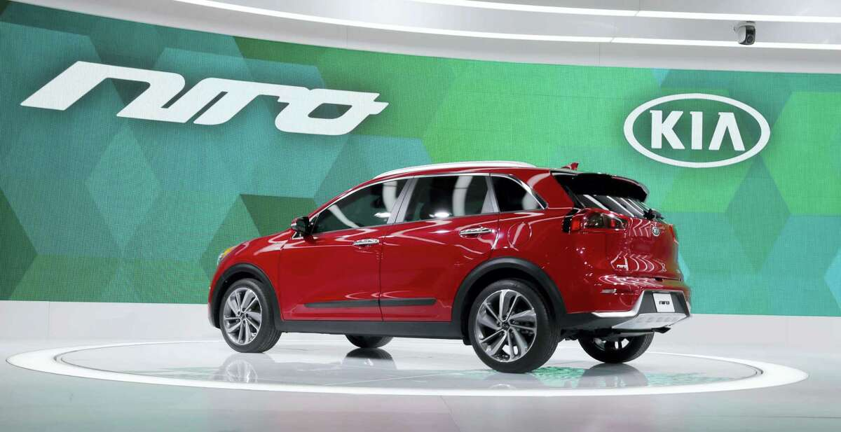 In this Thursday, Feb. 11, 2016 photo, the 2017 Kia Niro sits on display at the Chicago Auto Show, in Chicago. Kia has claimed the top spot in J.D. Power's annual initial quality survey of new vehicles for the second straight year.