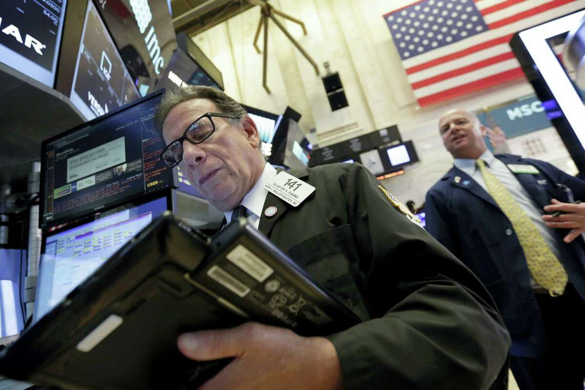 Traders Sal Suarino, left, and Patrick Casey work on the floor of the New York Stock Exchange Wednesday.