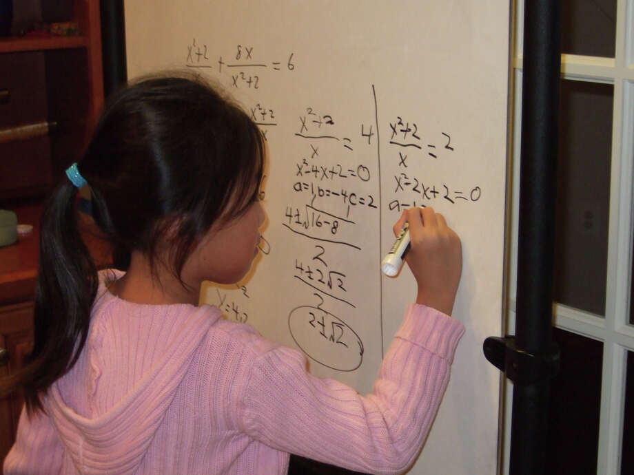 Stephanie Mui doing algebra in first grade. Photo: Family Photo Courtesy Of Stephanie Mui  / Family photo courtesy of Stephanie Mui