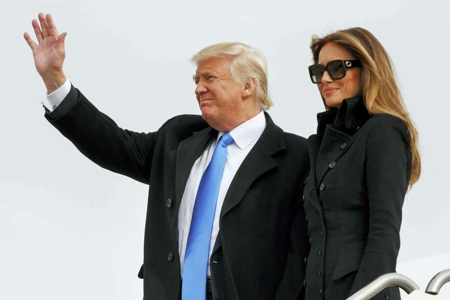 President-elect Donald Trump, accompanied by his wife Melania Trump, waves as they arrive at Andrews Air Force Base, Md., Thursday, Jan. 19, 2017, ahead of Friday's inauguration. Photo: AP Photo/Evan Vucci   / Copyright 2017 The Associated Press. All rights reserved.