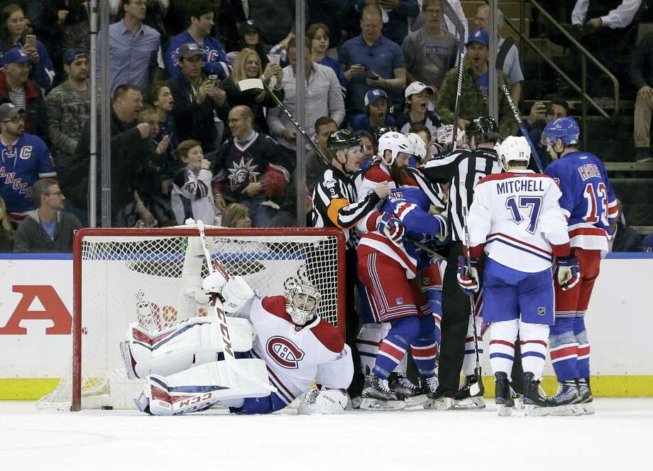 Canadiens goalie Carey Price, left, gets up off the ice while other players scuffle nearby during the first period Sunday. Photo: Seth Wenig — The Associated Press  / Copyright 2017 The Associated Press. All rights reserved.