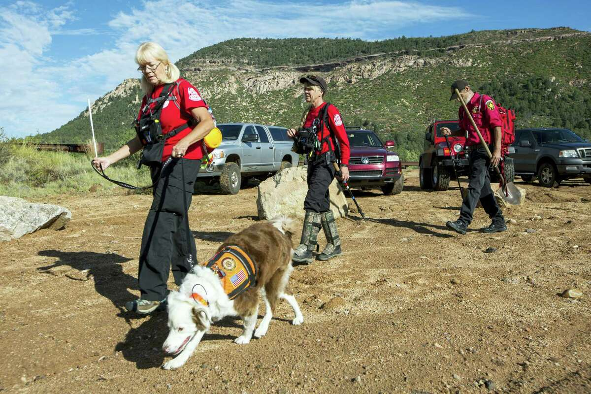 Volunteer rescuers from Navajo County begin searching for a missing 27-year-old man in Tonto National Forest, Ariz., Monday, July 17, 2017. The man was swept downriver with more than a dozen others when floodwaters inundated the area on Saturday.