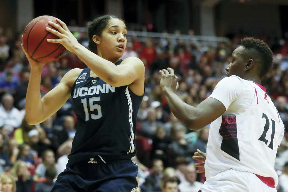 Connecticut's Gabby Williams (15) looks to pass against Cincinnati's Shanice Johnson (21) during the second half of an NCAA college basketball game, Tuesday, Feb. 7, 2017, in Cincinnati. Connecticut won 96-49. (AP Photo/John Minchillo) Photo: AP / AP