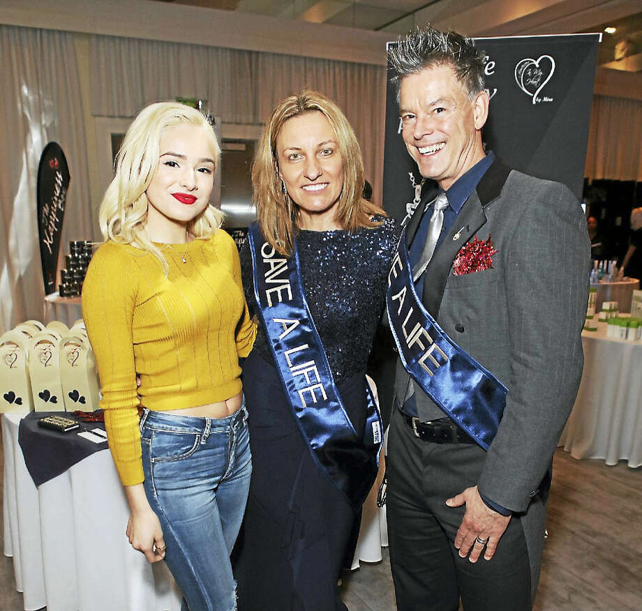 Middletown's Mira Jewelry owner Mira Alicki not only attended the Golden Globes earlier this month but her Forever in My Heart cremation bracelets were part of the goody bags. From left are dancer, choreographer and actress Chachi Gonzales, Alicki and her colleague Michael Anair at the awards ceremony Jan. 8 at the The Beverly Hilton in Beverly Hills, California. Photo: Contributed Photo