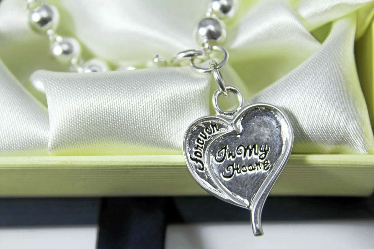 """This sterling silver bracelet, designed by Mira Alicki, with an engraved charm that reads """"Forever in My Heart"""" on one side and """"Rescue Me"""" on the other, was a part of swag bags given to Golden Globes attendees."""