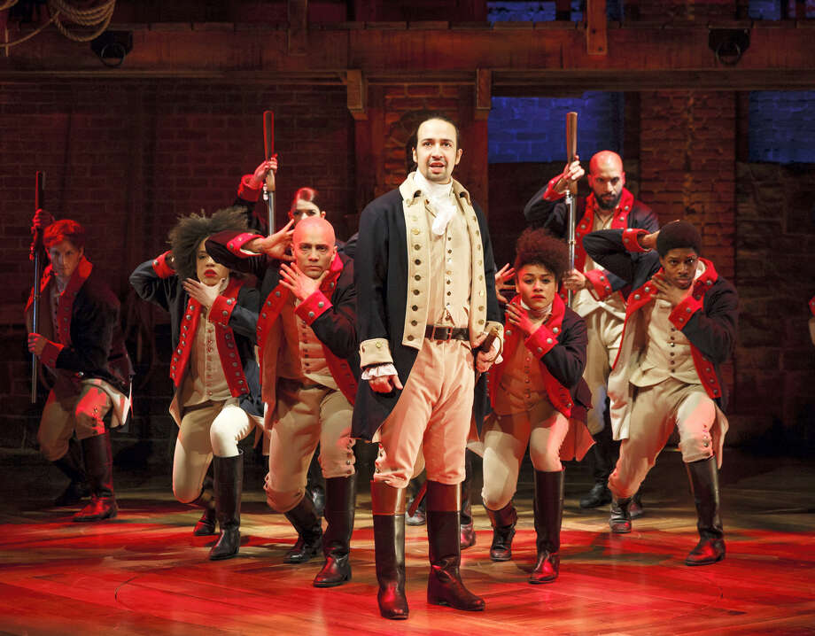"Wesleyan University graduate Lin-Manuel Miranda, foreground, is shown with the cast during a performance of ""Hamilton"" in New York. Photo: File Photo  / The Public Theater"