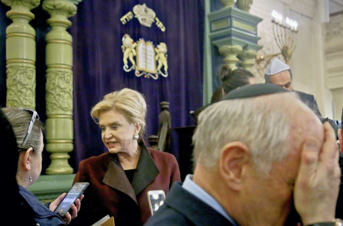 In this March 3, 2017 photo, Congresswoman Carolyn Maloney, center, a member of Congress's bipartisan task force combating anti-Semitism, speaks with a reporter after holding a news conference to address bomb treats against Jewish organizations and vandalism at Jewish cemeteries at the Park East Synagogue in New York. Kendall Sullivan, a Connecticut man who posted threats against Jews and synagogues on a metal music internet forum plans to argue at his sentencing that he has served enough time in prison. Sullivan is scheduled to go before a U.S. District judge in Bridgeport on Monday, April 17. He pleaded guilty in January to perpetrating a hoax and originally faced three federal charges of making online threats.