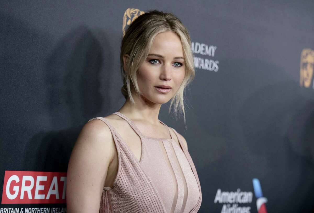 In this Oct. 28, 2016, file photo, Jennifer Lawrence arrives at the BAFTA Los Angeles Britannia Awards at the Beverly Hilton Hotel in Beverly Hills, Calif. Lawrence acknowledged on May 17, 2017, that a tabloid site'Äôs video of her dancing on a stripper pole is the real thing, but the actress says she'Äôs not sorry about it.