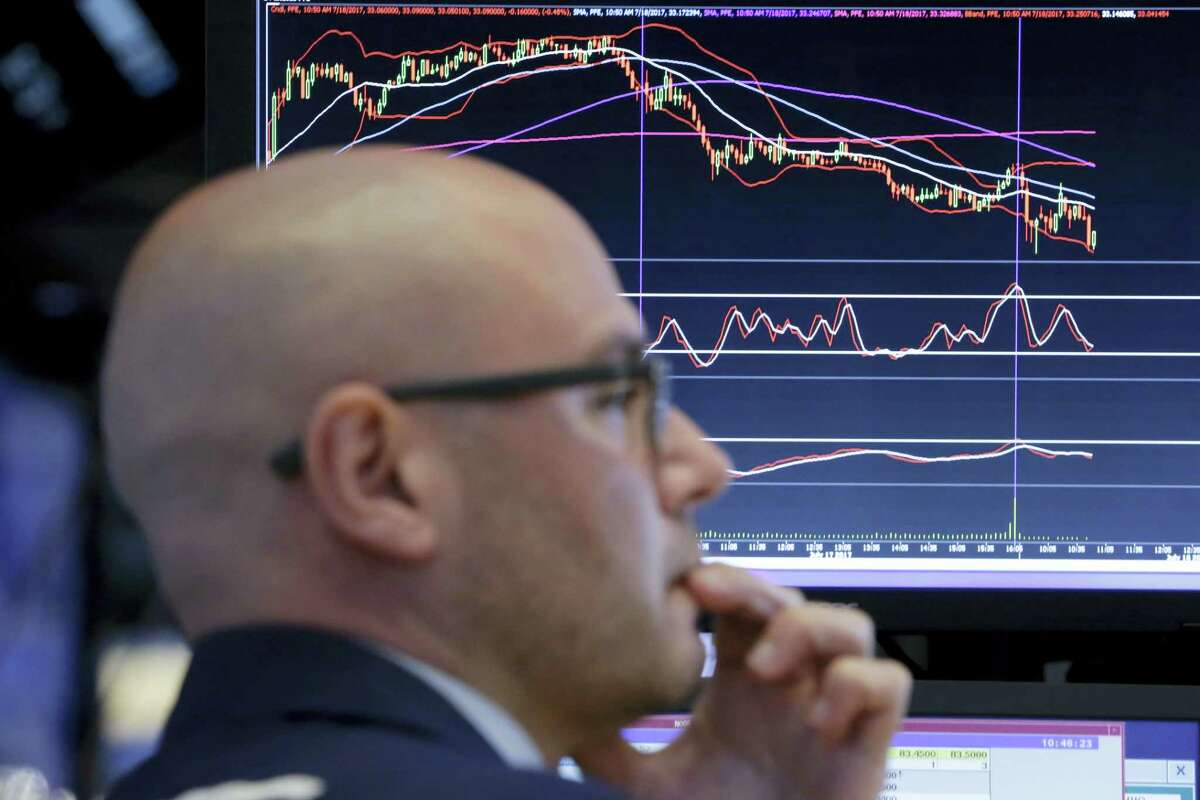Specialist Mario Picone works at his post on the floor of the New York Stock Exchange Tuesday.