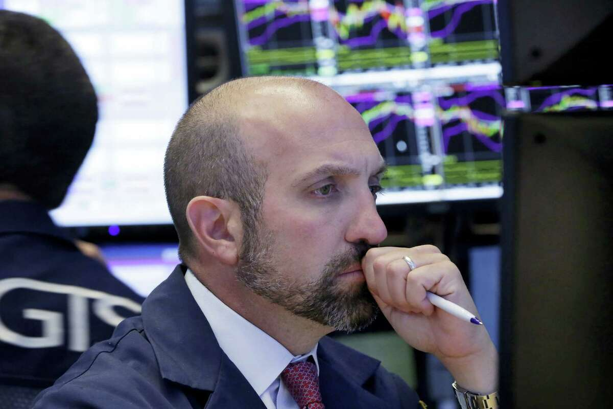 Specialist James Denaro works at his post on the floor of the New York Stock Exchange Tuesday.