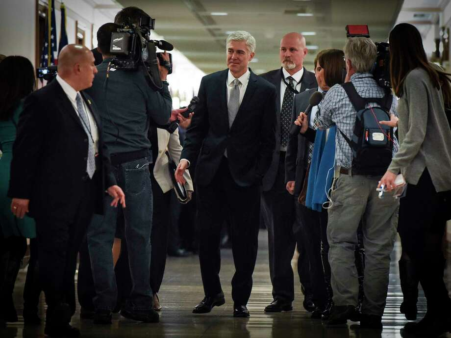 Supreme Court nominee Neil Gorsuch, center, walks through group of reporters on his way to visit Sen. Susan Collins, R-Maine, on Thursday. MUST CREDIT: Washington Post photo by Bill O'Leary Photo: The Washington Post / The Washington Post